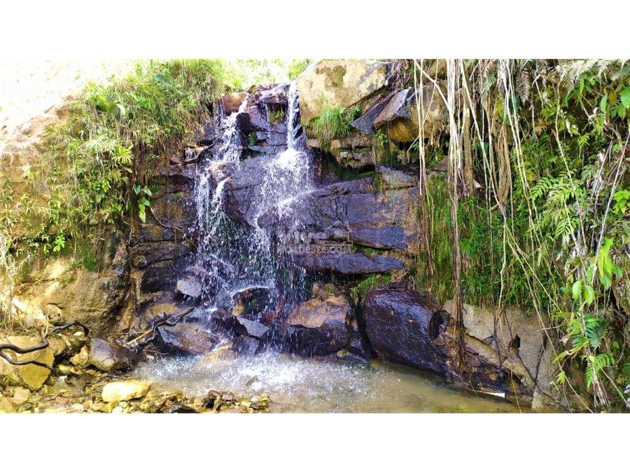 lote con hermosa cascada y apartamento en san roque ant