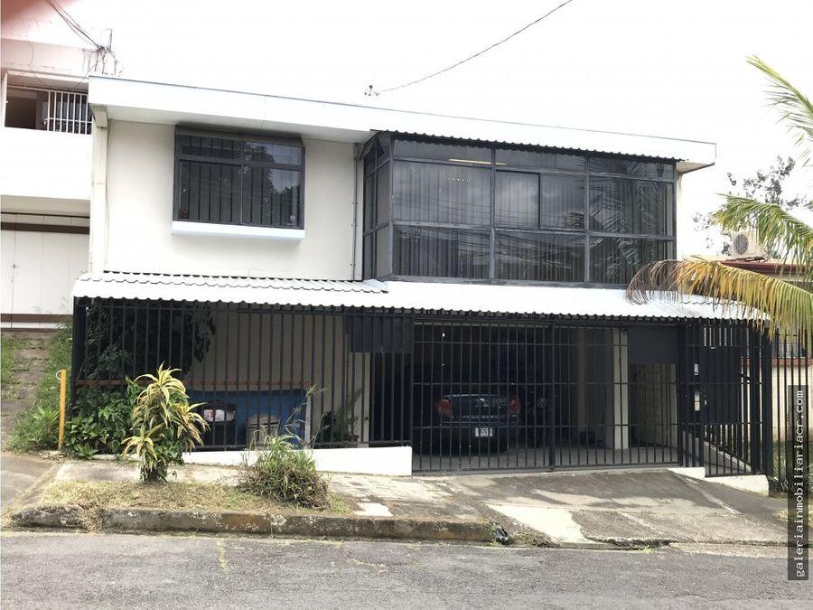 casa remodelada en oficina y dos apartamentos