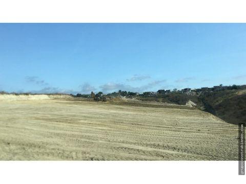 1 hectarea de terreno en la via interbarrial manta