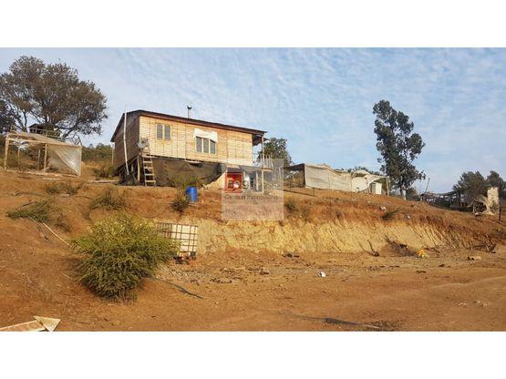 se vende parcela con casa sector rauten