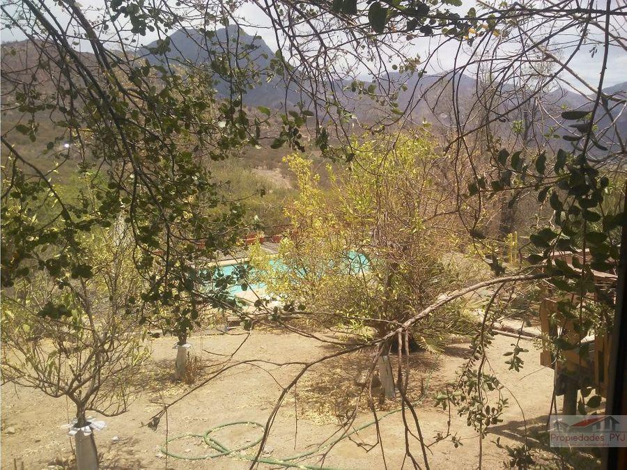 parcela con casa y piscina en oasis de la campana