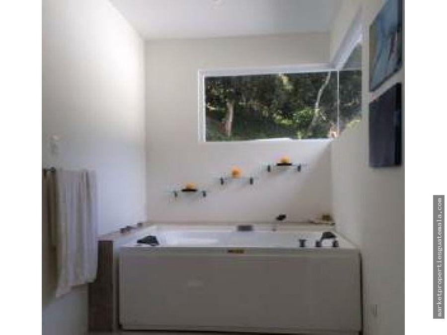 moderna casa en venta en muxbal guatemala