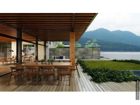 dos casas con frente al lago la pena