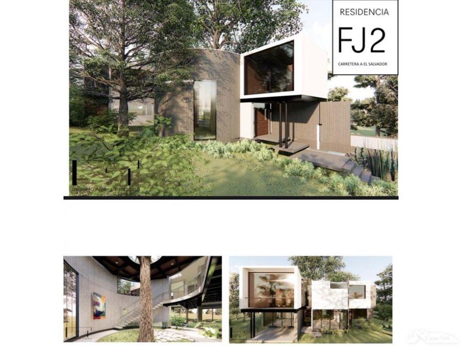 casa moderna con un arbol interno diseno unico