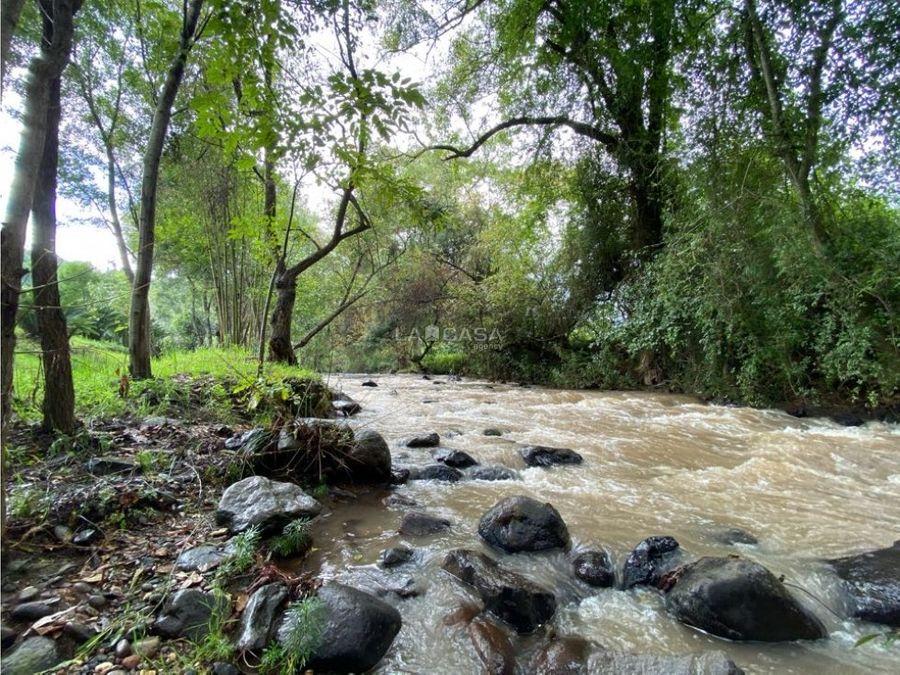 terreno plano con rio en tiloxtoc