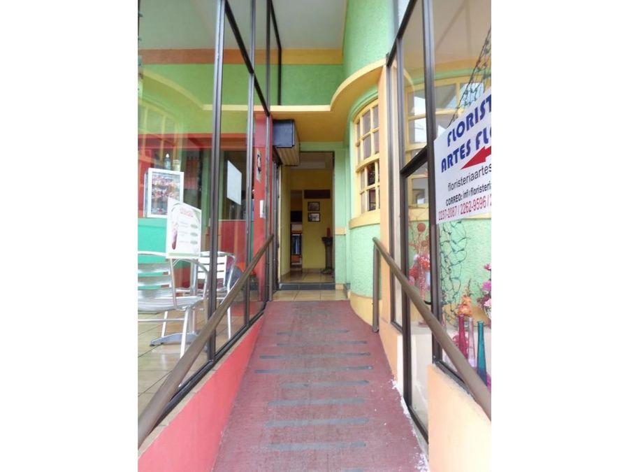 edificio centrico con locales comerciales heredia