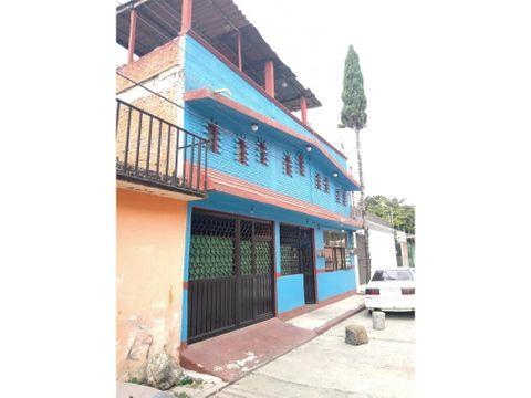 edificio con habitaciones para renta