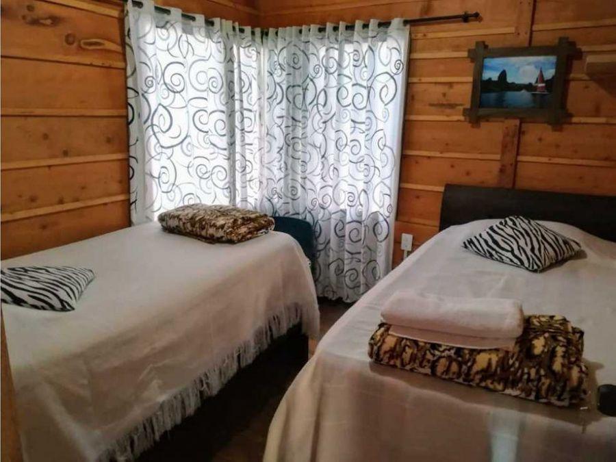 venta propiedad con 3 cabanas guatape