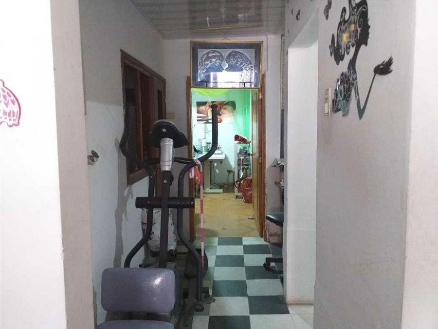 vendo casa y negocio acreditado confeccion 3 pisos